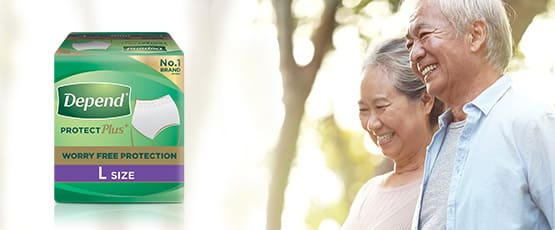 elderly couple smiling outdoors with Depend protection Pants product pack, and a 'learn more' button